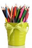Colorful pencils and felt-tip pens in green pail isolated on white