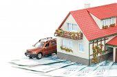 Dinheiro e casa em miniatura