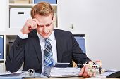 Stressed businessman sitting with burnout in his office