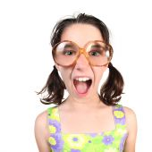 stock photo of laughable  - Funny Girl Wearing Large Eyeglasses Shouting Towards the Viewer - JPG