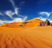 stock photo of algeria  - Sand dunes and rocks - JPG