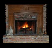 pic of cozy hearth  - A fireplace and mantel inside a cozy family room - JPG