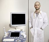 Portrait of young male technician operating ultrasound machine in white dress