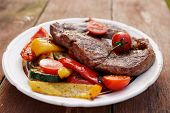 Kobe beef ribeye steak with grilled vegetables on old wooden table