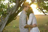Couple sweethearts under tree