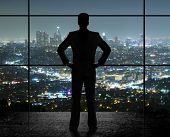 image of step-up  - man looks in night city - JPG