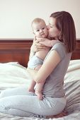 pic of naked children  - Portrait of a mother with her baby in bedroom at home - JPG