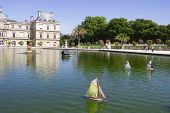 Traditional Small Wooden Sailing Boat In The Pond Of Park Jardin Du Luxembourg, Paris, France