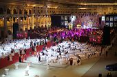 MOSCOW - MAY 25: Hall with tables and people in beautiful dress under purple lights at 11th Viennese