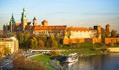 KRAKOW, POLAND - OCT 20: View of Royal Wawel castle and Vistula river, Oct 20, 2013 in Krakow, Poland. Vistula is the longest river in Poland, at 1,047 kilometres in length.