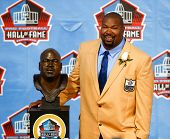 CANTON, OH-AUG 3: Former Dallas Cowboys offensive lineman Larry Allen poses with his bust during the