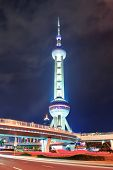 SHANGHAI, CHINA - MAY 27: Oriental Pearl Tower over river on May 27, 2012 in Shanghai, China. The to