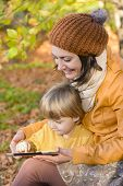 Mother And Son Having Fun With A Tablet Pc