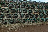 picture of lobster boat  - Lobster or crayfish pots stacked on fishing boat - JPG