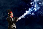 Image of wizard in red bow tie showing tricks