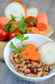 image of legume  - ingredients for soups legumes in water with carrot onion and tomato - JPG