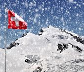 Strahlhorn with Swiss flag in winter - Wallis, Swiss alps