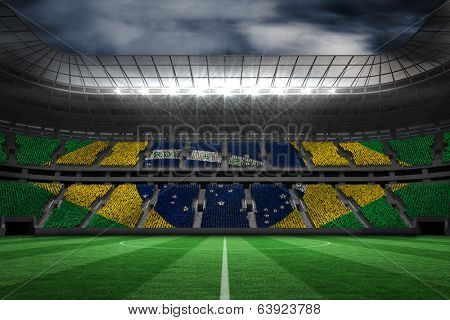 Digitally generated brazilian national flag against large football stadium poster