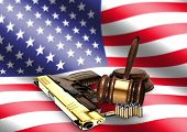 Gavel And Hand Gun With American Flag