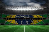 picture of patriot  - Digitally generated brazilian national flag against large football stadium - JPG
