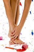 image of painted toenails  - Sexy pair of feet and hands surrounded by colorful paint splatter - JPG