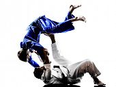 pic of judo  - two judokas fighters fighting men in silhouettes on white background - JPG