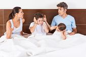 family conflict parents bed, couple children