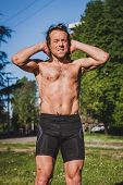 foto of chest hair  - Mature long haired athlete getting ready for running - JPG