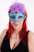 Young Plump Red-haired Woman With Mask