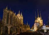 two cathedrals on a mountain at night in Erfurt, Germany