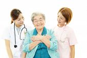 Smiling medical staff with old woman