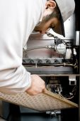image of hvac  - Stock image of HVAC technician replacing filter on furnace - JPG