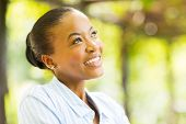 picture of daydreaming  - cute young african woman daydreaming - JPG