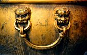 Copper ancient  pot with lion statue decoration in Forbidden City in Beijing, China.