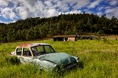 Abandoned classic car in a field