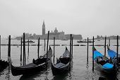 Empty gondolas in Venice during winter