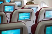 DOHA, QATAR - FEBRUARY 18, 2014: Economy class seats with entertainment system onboard. Qatar Airway