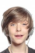 Smiling Cute Teenager Boy With Headphones, Isolated On White