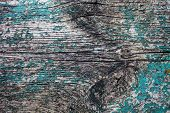 Old Wooden Plank With The Remains Of Cracked Blue Paint