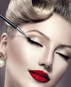 Makeup. Vintage style Make-up Applying closeup. Eyeliner. Retro styled Woman. Eyeline brush for Make