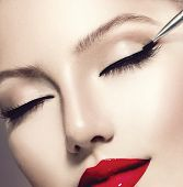 Makeup. Perfect Make-up Applying closeup. Eyeliner. Cosmetic Eyeshadows. Eyeline brush for Make up.