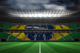 picture of football pitch  - Digitally generated brazilian national flag against large football stadium - JPG
