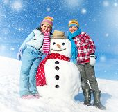 Children having fun with a Snowman.