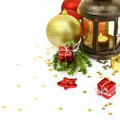 Christmas lantern and ornaments isolated on white