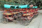 DELHI, INDIA - November 30, 2012: Many rickshaw on parking in Delhi