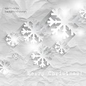 eps10 vector overlapping snowflakes on crumpled paper Christmas concept background