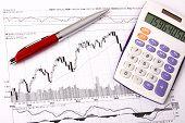 Calculator, A Red Pen On A Financial Chart