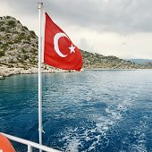 Turkish flag on a background of sea and sky