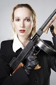 "pic of tommy-gun  - Mafia style fashion studio portrait - nice young woman posing with ""Tommy"" gun for figure and portrait photos in retro criminal style.