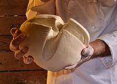 Cook hands holding a dough ball
